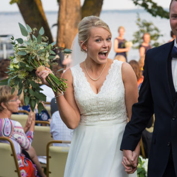 Hooray! The first photos as Mr. and Mrs. are the BEST! | MN Wedding Photography